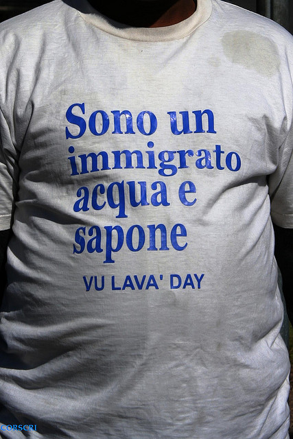 "An immigrant's t-shirt saying ""I am an immigrant using soap and water"" to avoid abuse. By Cristiano Corsini on Flickr (CC BY-NC-SA 2.0)."