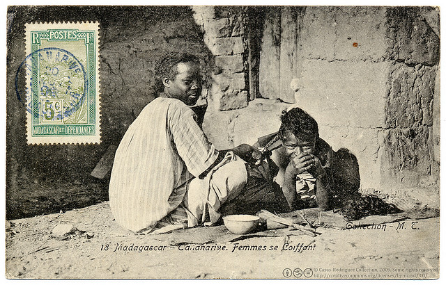 Women doing their hair- Antananarivo, Madagascar. Vintage photographic postcard, c.1907, photograph by Collection M. T., printed by Ateliers de Phototypie Guende, Marseille, France. Shared by postaletrice on Flickr (CC-BY-NC-3.0)