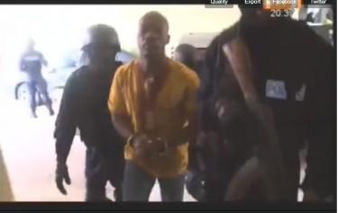 Charles blé goudé in handcuffs