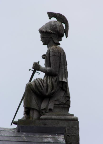 Blind justice - Statue on former court buildings, Caernarfon ( Creative Common License on Flickr, Siaron James)
